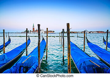 Venice, gondolas or gondole on a blue sunset twilight and...