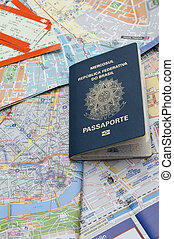 Passport, maps, and tickets on the table