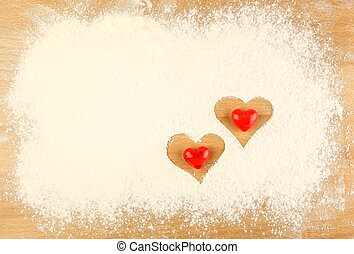 Flour on the table with hearts