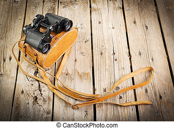 Old Binoculars - Pair of old binoculars with vintage leather...