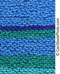 Knitted blue and green wool stripes abstract texture...