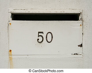 the number fifty on an old letterbox
