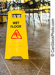 Wet floor sign - yellow wet floor sign put on wet floor when...