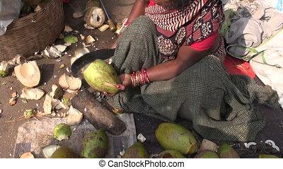 peeling coconut in asia market
