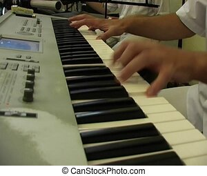 hands play on keyboards - hands of musician play on the...