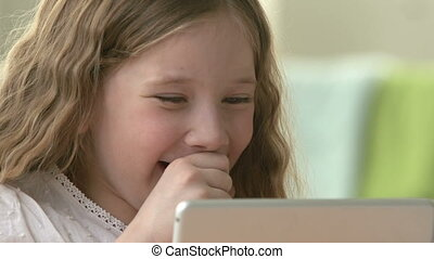 Funny Things on the Screen - Close-up of female child with...