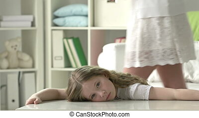 Mother Care - Bored girl entertained by mother bringing...
