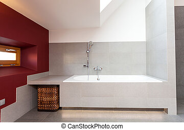 White bath in modern bathroom with red wall