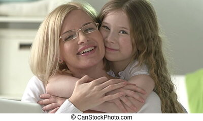Love and Affection - Woman hugging and caressing her preteen...