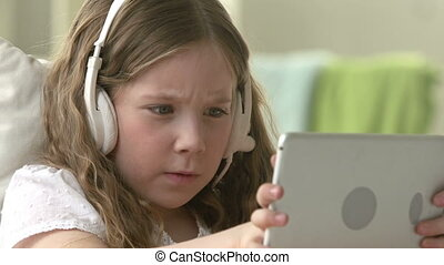 Playing Online Games - Girl of 8-10 years playing games on...
