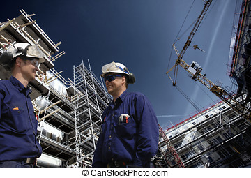 building workers and construction - two construction workers...
