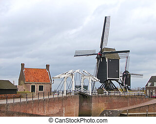 Bascule bridge and windmill in Heusden Netherlands