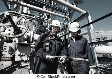 oil and gas workers inside refiner - oil and gas workers...