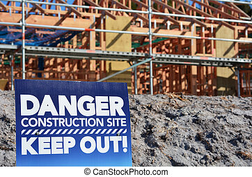 Danger building site sign in a new home construction site....