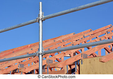 New home roof construction framework in a construction site....