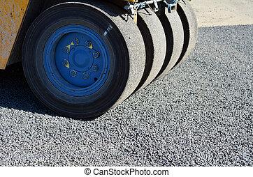 Road roller on asphalt pavement works (road repairing)