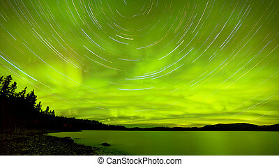 Startrails Northern Lights show over Lake Laberge -...