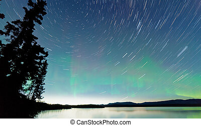 Lake Laberge startrails Aurora borealis display -...