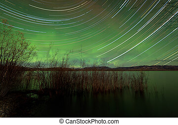 Startrails Aurora borealis display Lake Laberge -...