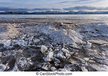 Shore ice piling up Lage Laberge Yukon Canada - Shore ice...