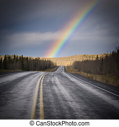 Rainbow country road dark Yukon nature landscape - Wet...