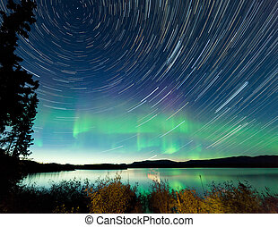 Startrails Northern Lights display Lake Laberge -...