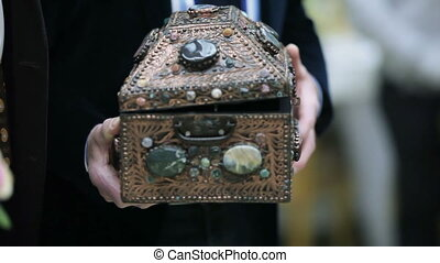 Chest for gifts - Man holding an antique chest for gifts