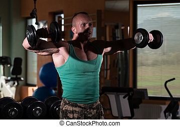 Exercise For Shoulders Dumbbell Lateral Raise - Young Man...