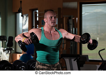 Bodybuilder Weight Lifting with Dumbbell - Young Man...