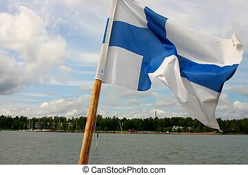 Finnish flag - Finlands flag mounted on a boat