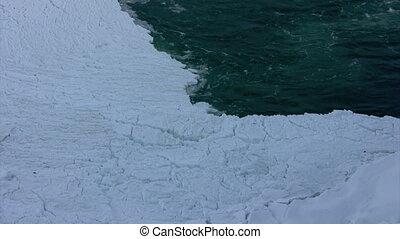 ice jam - water flows into ice jam