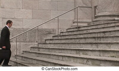 Man on Steps of Building - Stock Video Footage of a man...