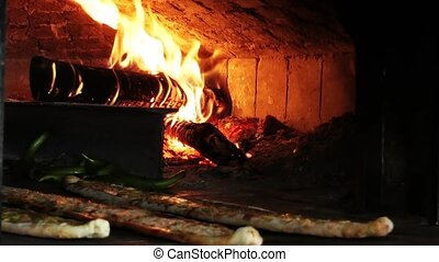 Wood Fire in the Oven and Meat Pita