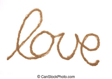 Word love written with sand