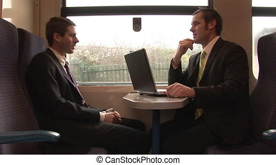 Businessmen working in a train
