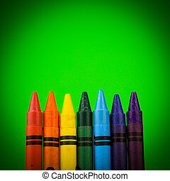Crayons - Set of colour crayons on green background