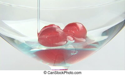 Cherries in a champagne glass - Champagne glass with...