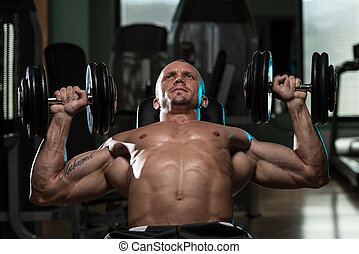 Man Doing Dumbbell Incline Bench Press Workout - Handsome...
