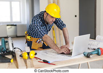 Portrait of hard working building contractor