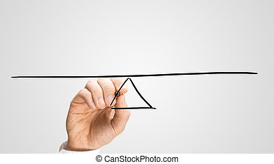 Man drawing a seesaw to demonstrate the concept of a lever...