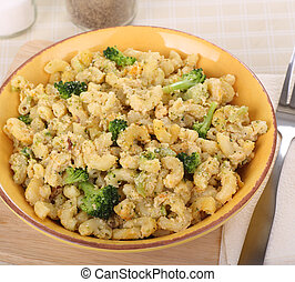 Mac and Cheese - Bowl of macaroni and cheese with broccoli