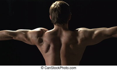 Bodybuilding Effects - Man revealing his back muscles and...