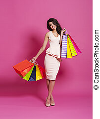 Beautiful woman with luxurious shopping