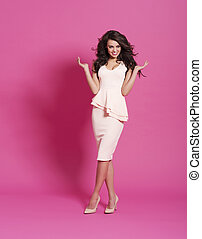 Fashion model posing on pink background
