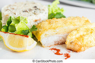 Fish baked with cheese and risotto - Fish fillet baked with...