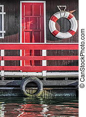 Old Wooden Red Painted Raft Hut
