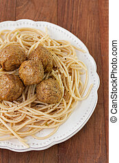 meatballs with spaghetti in plate on dark background