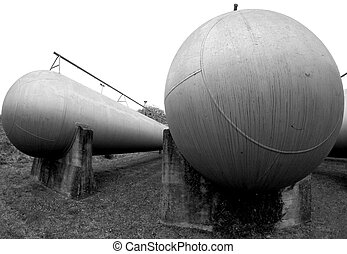 huge oblong tanks in industrial plant outside of the factory...