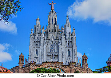 Tibidabo church in Barcelona with statue of Jesus Christ...