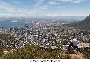 Viewing Cape Town - A man enjoying the scenics of Cape Town,...